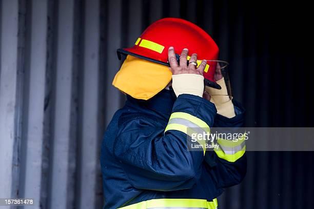 Fireman checking visor on his helmet