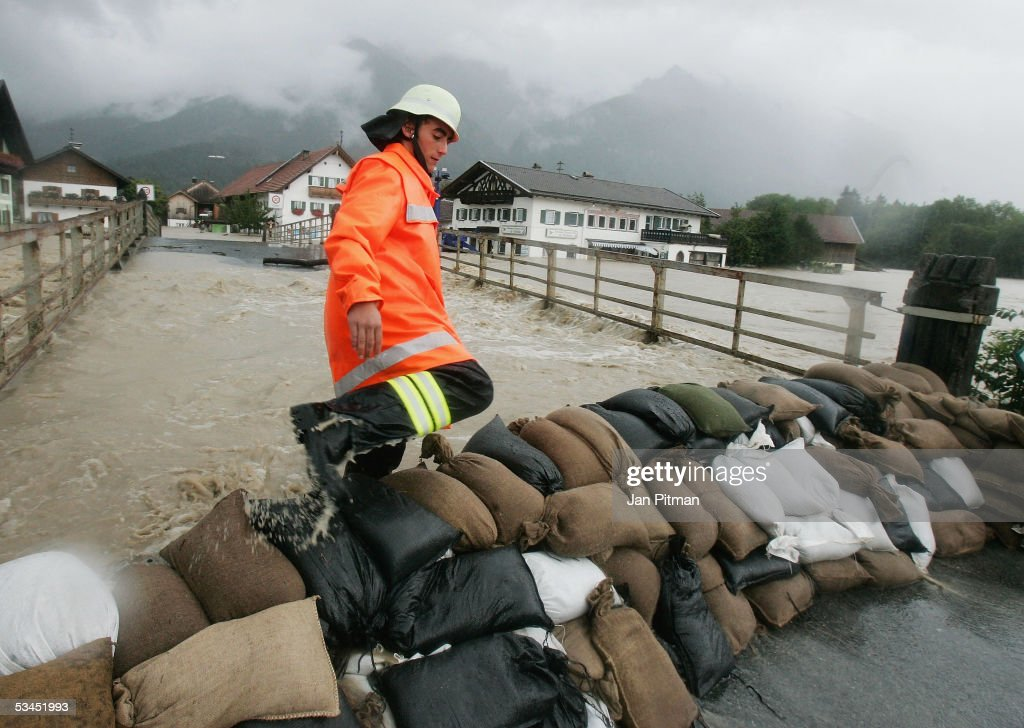 A fireman climbs over a barrier of sandbags on August 23, 2005 in Eschenlohe, Germany. Heavy rainfall and floods in both Austria and Switzerland caused many of the rivers in southern Germany to flood. Half of Eschenlohe town has been evacuated and streets in the whole area are closed to traffic.