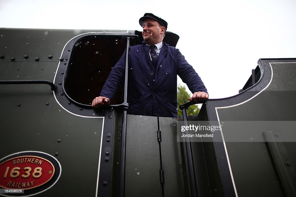 Fireman Darren French steers the The Grinstead Belle into East Grinstead Station for the first time on March 23, 2013 in East Grinstead, England. The Bluebell Railway ran its first steam train this weekend on the reclaimed line from Kingscote to East Grinstead after volunteers from the Bluebell Society worked to reopen the line after its closure on March 17, 1958. 50 years on from Dr. Richard Beeching's report signaling the widespread closure of rural rail routes across the UK, Britain's railways are in great demand with old lines reopening and pressure on to restore rural lines that were closed.