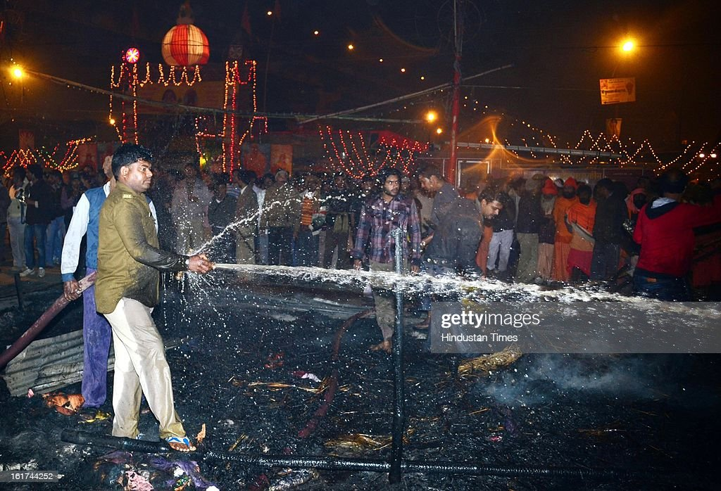 Fireman dousing the flames in the Kumbh Mela area, on February 15, 2013 in Allahabad, India. A sadhu was reportedly dead in early morning fire at Kumbh Mela Camp.