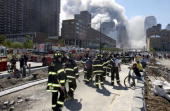 Fireman heading south on the West Side Highway towards the remains of the World Trade Center where smoke continued hours after the colapse Streets of...