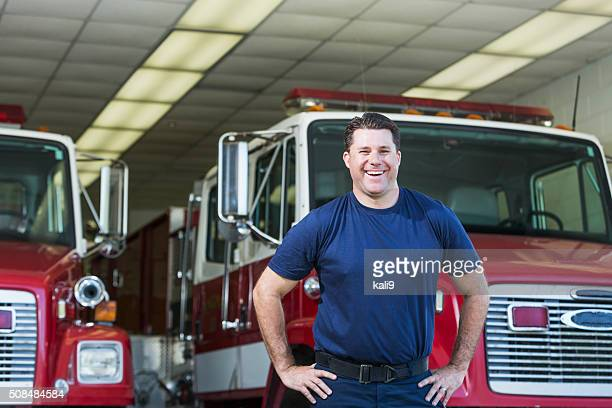 Fireman in front of fire truck