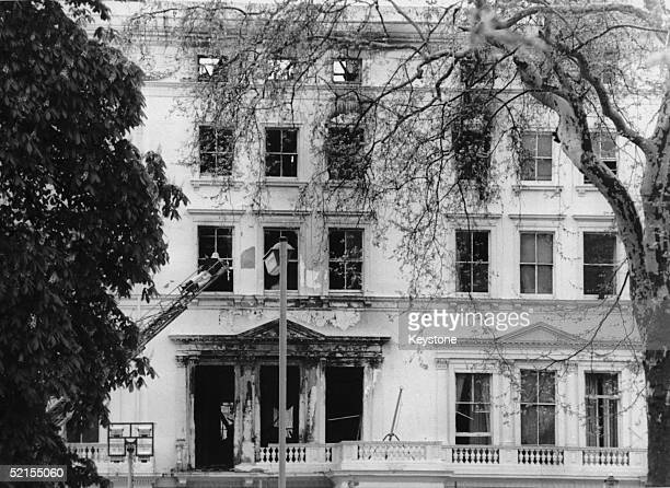 A fireman inspects damage to the Iranian Embassy in South Kensington London 6th May 1980 The damage was caused by the storming of the building by...