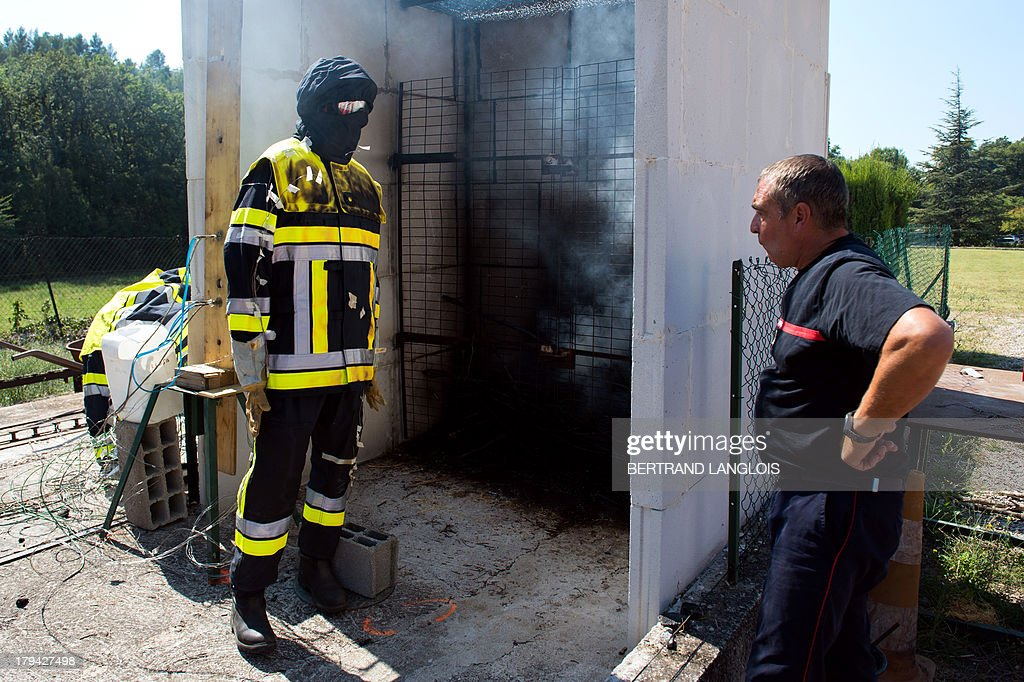 A fireman is pictured after testing a new protective suit to fight against the forest blazes on September 3, 2013 in Gardanne near Marseille, southeastern France.