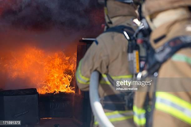Fireman putting out a living fire