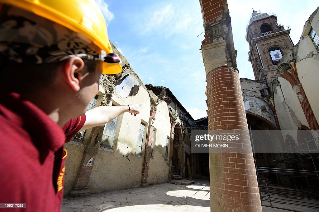 Fireman Salvatore Cardaci, coordinator of works, shows parts of the damaged church (duomo) in Mirandola on May 22, 2013 a year after an earthquake in the Emilia Romagna. Reconstruction efforts in Emilia Romagna in Italy are proceeding slowly a year after two powerful earthquakes wrecked homes and businesses in this rich farming and medical industry region.