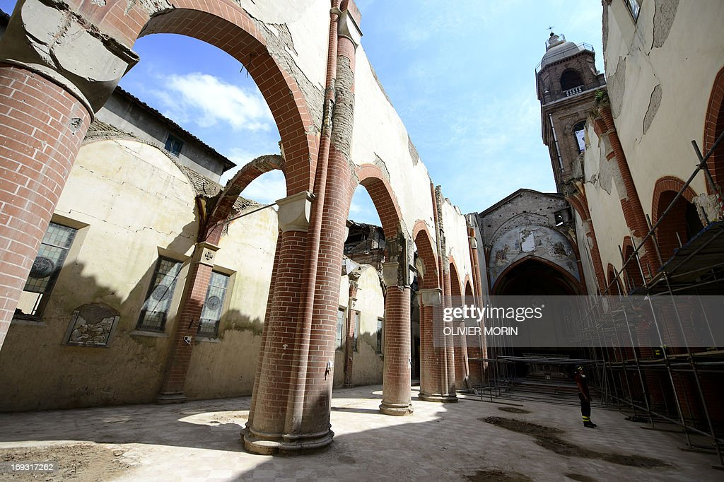 Fireman Salvatore Cardaci, coordinator of works, shows parts of the damaged church (duomo) in Mirandola on May 22, 2013 a year after an earthquake in the Emilia Romagna