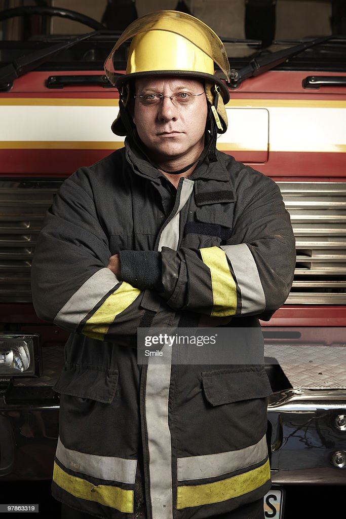 Fireman standing in front of fire truck