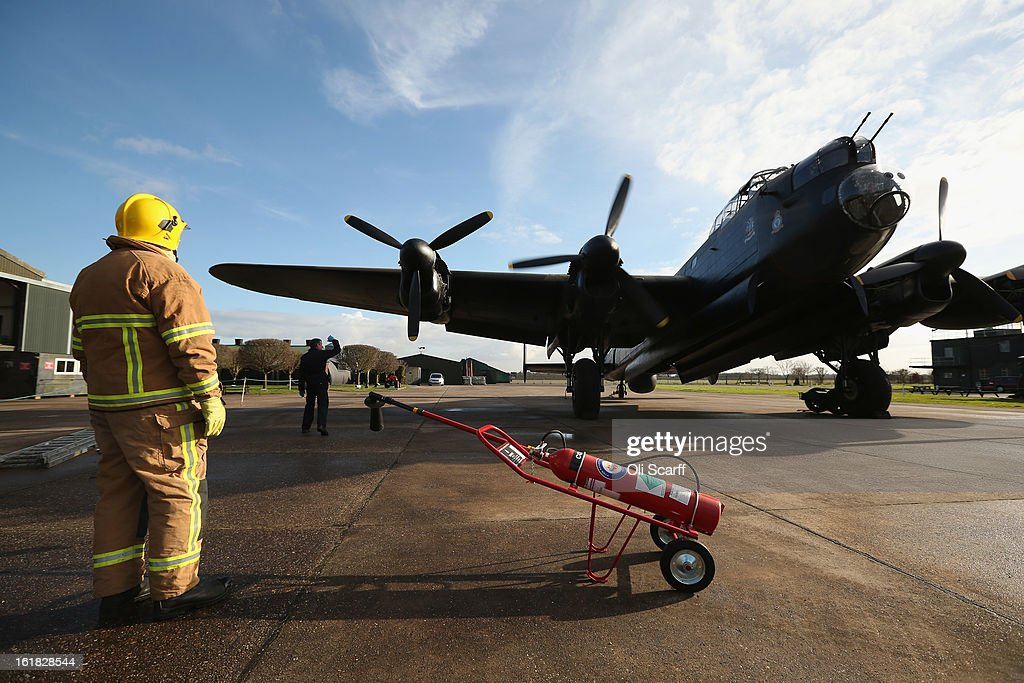 A fireman stands by as engine tests are carried out on the Lancaster bomber 'Just Jane' which is being restored with the aim of getting it airworthy, at Lincolnshire Aviation Heritage Centre, on February 14, 2013 in East Kirkby, England. The plane, which last flew in 1971, would become one of only three airworthy Lancaster bombers in the world. Brothers Fred and Harold Panton, owners of the Lincolnshire Aviation Heritage Centre, are restoring the plane in memory of their sibling, Christopher Panton, who died aged 19 when his Lancaster was shot down in 1944.