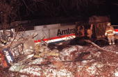 A fireman stands near the front end of the Amtrak train and the Marc commuter train that collided 16 February in Silver Spring MD Six people are...