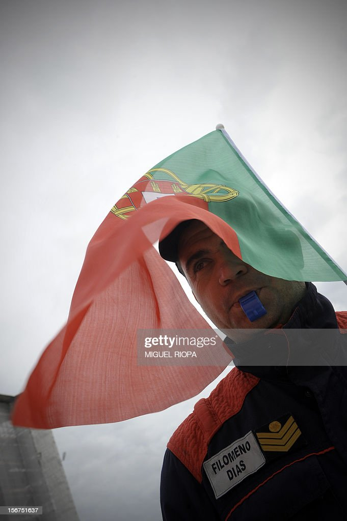 A fireman takes part in a demonstration against the govenrment's austerity policies at Comercio Square in Lisbon, on November 20, 2012. The government aims to save 4.0 billion euros via state reform measures, but its austerity budgets have led to howls of protest from civil servants and trade unions in particular.