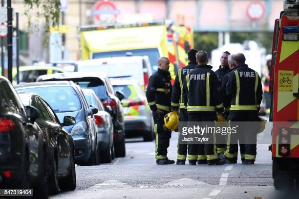 Fireman talk within the police cordon at Parsons Green Underground Station on September 15 2017 in London England Several people have been injured...
