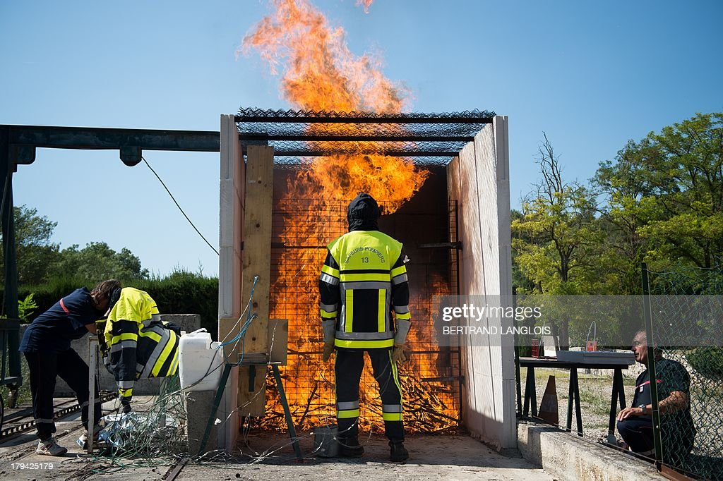 A fireman tests a new protective suit to fight against the forest blazes on September 3, 2013 in Gardanne near Marseille, southeastern France.