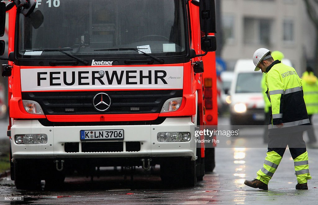 A fireman waits next to his car during the clean up the ruine of the building of the Historical Archive of the City of Cologne on March 6, 2009 in Cologne, Germany. Cologne's six-story city archive building groaned then collapsed in a pile of rubble Tuesday earlier this week as people inside fled in panic. The archive building collapsed about 2 p.m., ripping open and dragging down parts of two adjacent buildings that contained apartments and an amusement arcade. Two people are still missing. Unofficial voices make responsible the works in process on a new underground 'Nord-Sued' line which is passing by right under the collapsed building. Cologne has archive material going back over centuries, including manuscripts by communist pioneers Karl Marx and Friedrich Engels and documents related to German writer Heinrich Boell.