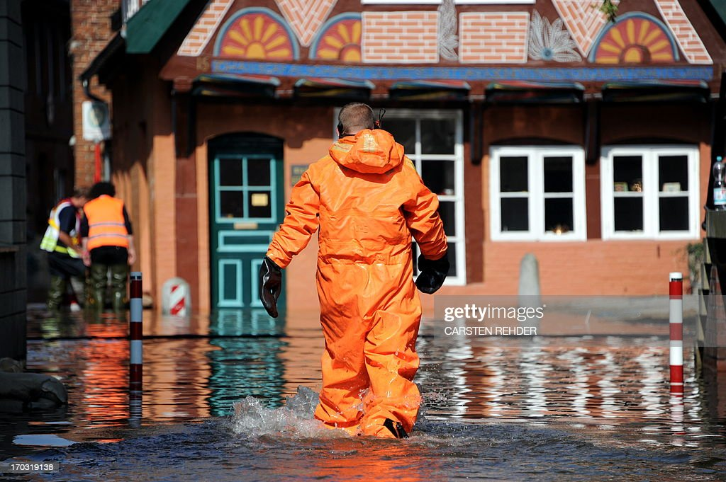 A fireman walks through the old town of Lauenburg, northern Germany, flooded by the river Elbe on June 11, 2013. Deadly floods forging a path of devastation through central Europe for more than a week bore down on northern Germany as troops raced to bolster sodden dykes.