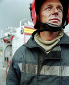 Fireman wearing safety helmet, close-up