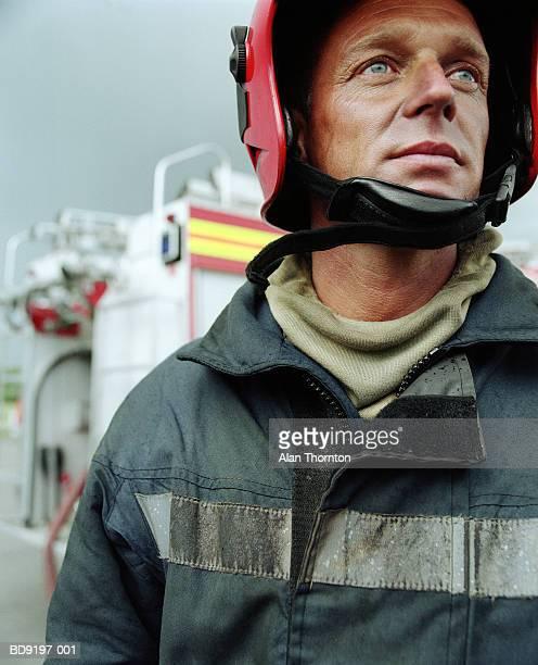 Fireman wearing safety helmet, close-up