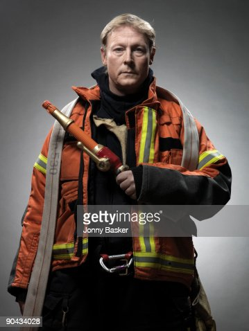 Fireman with water hose, portrait