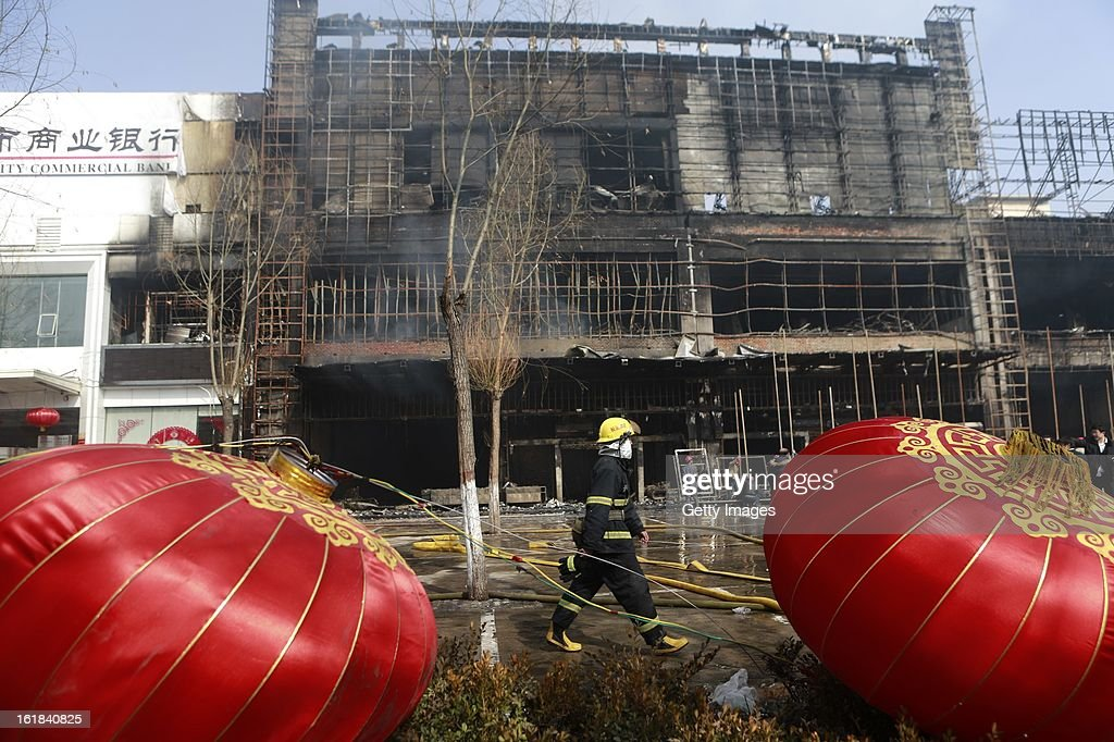 A fireman works at a fire site at a supermarket on February 17, 2013 in Changzhi, China. The supermarket caught fire at 4:10 a.m. today and was put out two hours later without any reports of casualties.