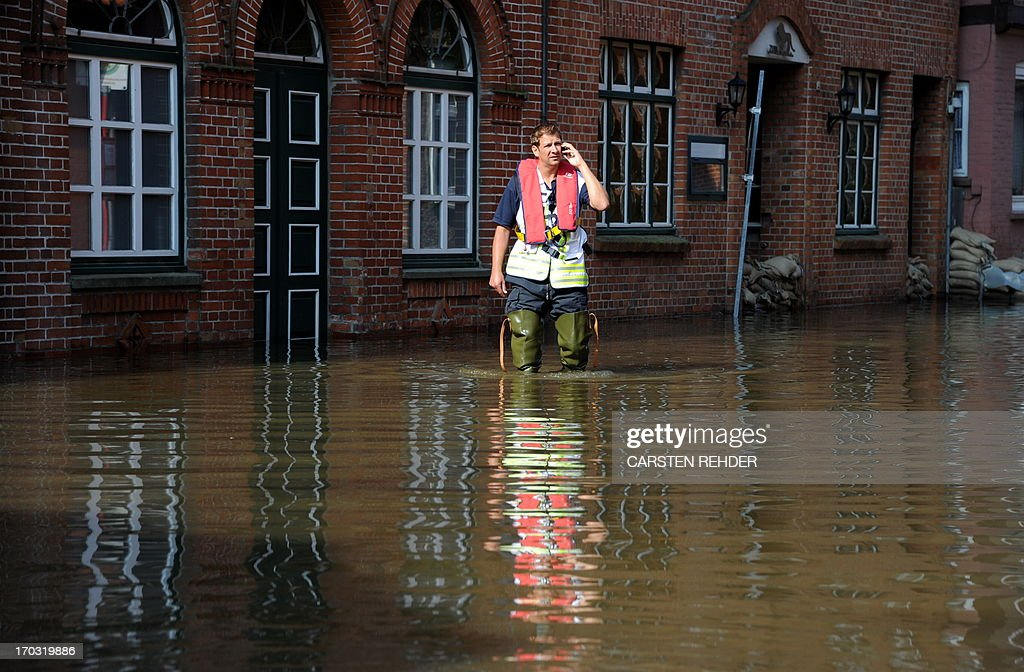A fireman works in the old town of Lauenburg, northern Germany, flooded by the river Elbe on June 11, 2013. Deadly floods forging a path of devastation through central Europe for more than a week bore down on northern Germany as troops raced to bolster sodden dykes. AFP PHOTO / CARSTEN REHDER / GERMANY OUT
