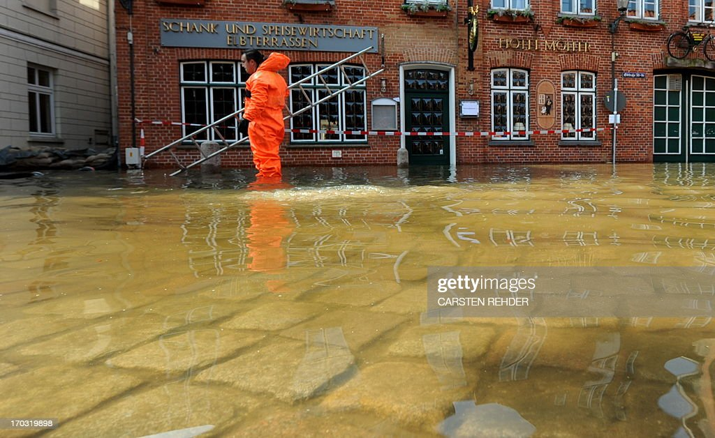 A fireman works in the old town of Lauenburg, northern Germany, flooded by the river Elbe on June 11, 2013. Deadly floods forging a path of devastation through central Europe for more than a week bore down on northern Germany as troops raced to bolster sodden dykes.