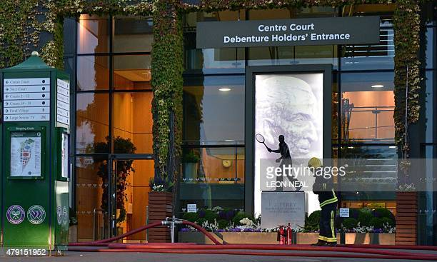 A Fireman works outside Centre Court following a fire alert and evacuation on day three of the 2015 Wimbledon Championships at The All England Tennis...