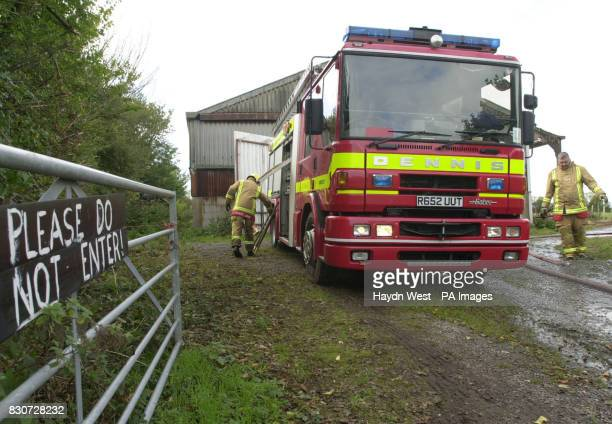 Firemen after extinguishing a fire at Red Gables farm in Appleby Magna Leicestershire which is thought to have been set alight by a couple knocking...