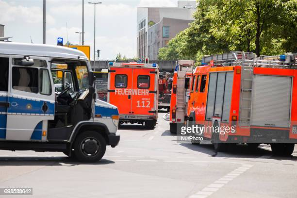 Firemen and police cars are seen in Kreuzberg after a fire broke out in a construction site in Berlin Germany on June 19 2017