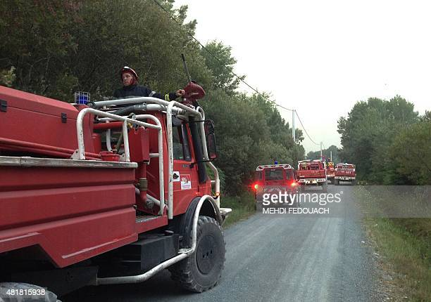 Firemen arrive at the site of a wildfire near SaintJean d'Illac some 20km of Bordeaux on July 24 2015 About 150 firefighters and Canadair...
