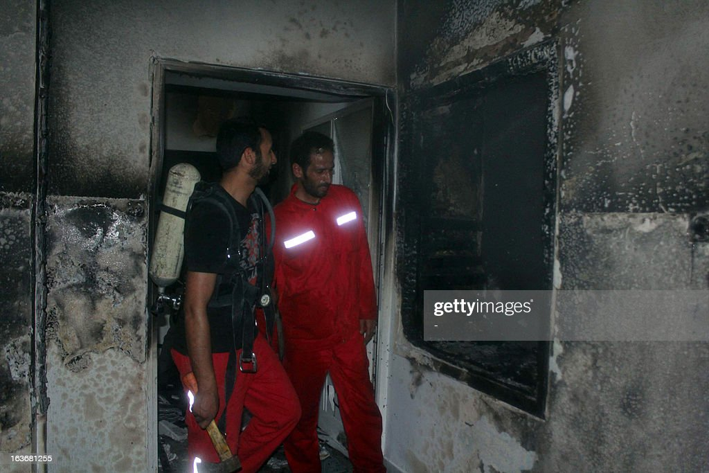Firemen assess the damage at an Egyptian Coptic church in the eastern Libyan city of Benghazi after gunmen attacked the religious site and started a fire on March 14, 2013. Since the 2011 revolution that ousted Moamer Kadhafi, Libya's small Christian minority has expressed fears over Islamic extremism, especially with the rise of armed militias enforcing their own law in the absence of central control. AFP PHOTO / STR
