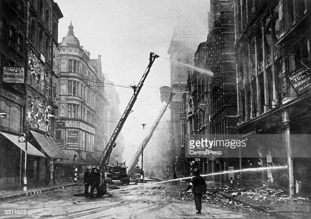 Firemen at work on fires the result of bombs dropped by the Germans near St Paul's Cathedral London