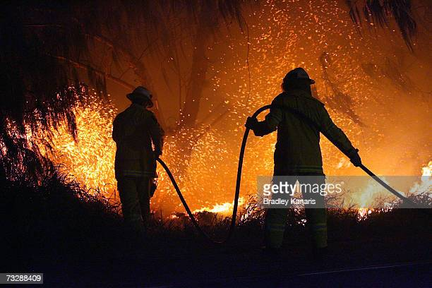 Firemen attempt to put out a fire outside of the Gold Coast stop of the 2007 Good Vibrations Festival at Doug Jennings Park on February 11 2007 in...
