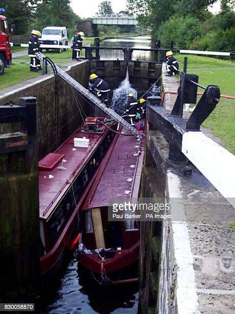 Firemen attend the scene at a lock on the Leeds Liverpool canal near Skipton North Yorkshire where four people died this afternoon The four people...
