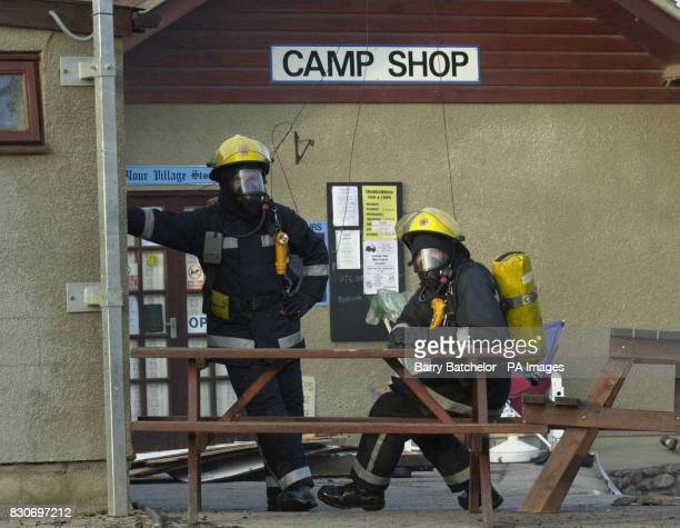 Firemen await instructions More than 40 firefighters tackling a blaze at a campsite and horse riding centre on the busiest holiday weekend of the...