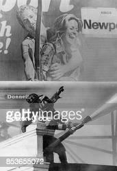 Firemen battle a fire at 536 Dudley Street in Boston April 21 1977