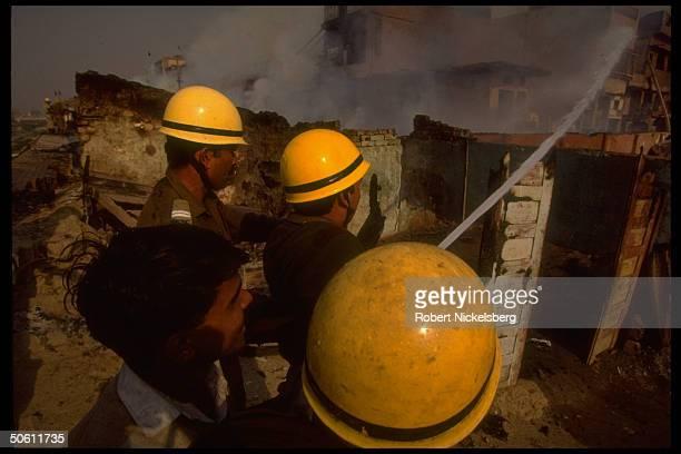 Firemen battling blazes set by Hindu mobs burning Muslim homes in rioting sparked by militant Hindu razing of Ayodhya Babri Mosque
