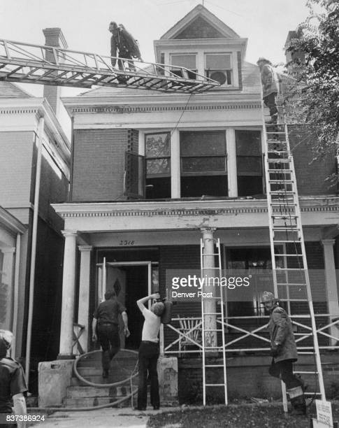 Firemen Clean Up After Thursday Blaze Burglars apparently broke into this threestory home at 2318 Marion St and set it afire Assistant Chief Frank...