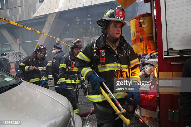 Firemen depart after fighting a building fire following an explosion on 2nd Avenue in the East Village on March 26 2015 in New York City The...