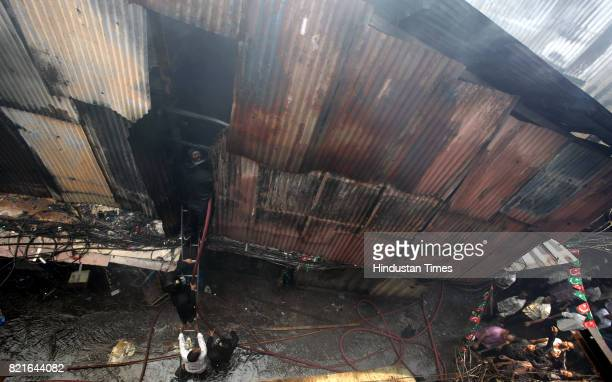 Firemen douse the blaze that broke out in Chhota Sonapur Lokhand Merchants Welfare Association at Grant Road on Tuesday Around 22 to 24 shops were...