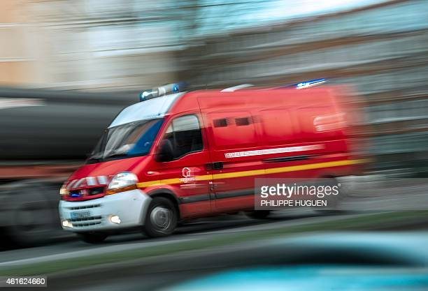 Firemen drive a first aid truck on January 16 2015 in Roubaix AFP PHOTO PHILIPPE HUGUEN