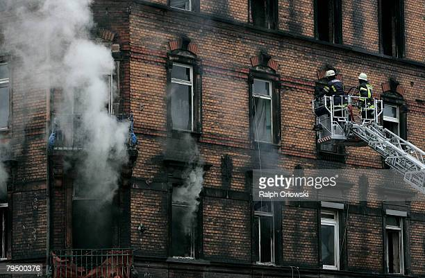 Firemen examine a burnt down house February 4 2008 in Ludwigshafen Germany Sunday evening the apartment building caught fire nine people died and...