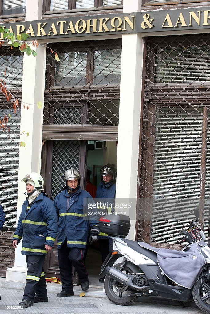 Firemen exit the building of the Deposits and Loans Fund after Greek police arrested a pensioner who had threatened to set himself on fire inside the state finance office , on November 22, 2012 in the northern city of Thessaloniki. Police and firemen broke into an office where the man was holed up for around two hours after turning up with a flare gun and a can of petrol which he poured over himself. The man is thought to be a 62-year-old who a decade ago was implicated in a fraud case involving slot machines and who was protesting the state's seizure of some of his assets. AFP PHOTO /Sakis Mitrolidis
