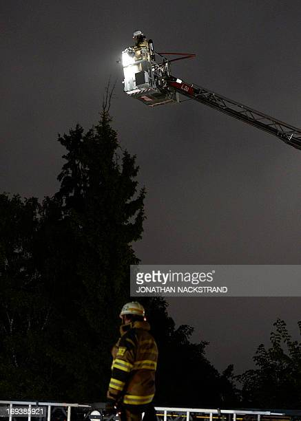 Firemen extinguish a blaze at a nursery school in the Stockholm suburb of Kista after youths rioted in several different suburbs around Stockholm...
