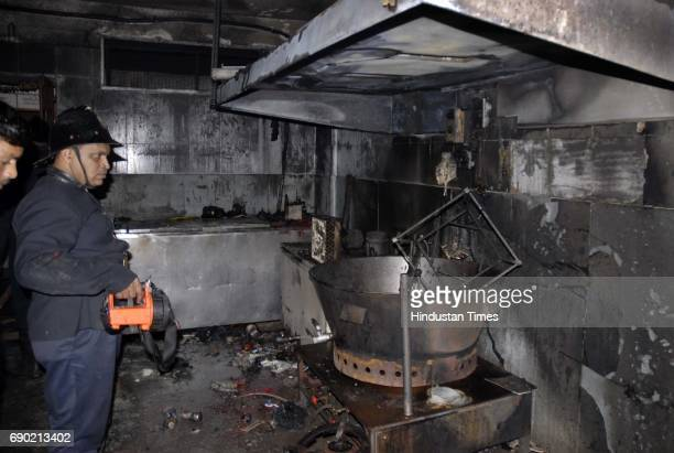 Firemen extinguish a blaze that broke out at a store near Shivaji Park Dadar The store which produces milk products caught fire due to a gas pipe...