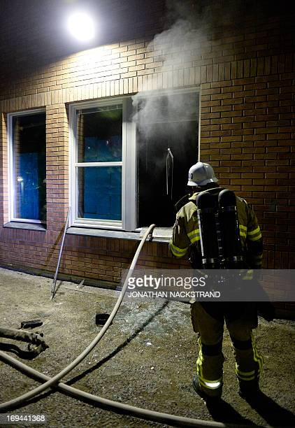 Firemen extinguish a burning school room in the Stockholm suburb of Tensta after youths rioted in few different suburbs around Stockholm and Sweden...