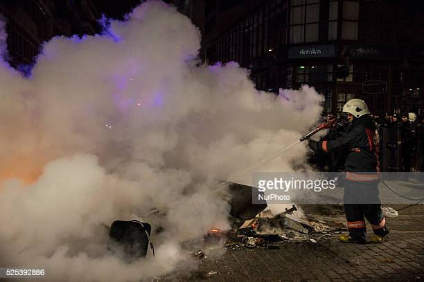 Firemen extinguish a fire lit by protesters on February 25 following the release of tapped phone conversation allegedly between Prime Minister Recep...