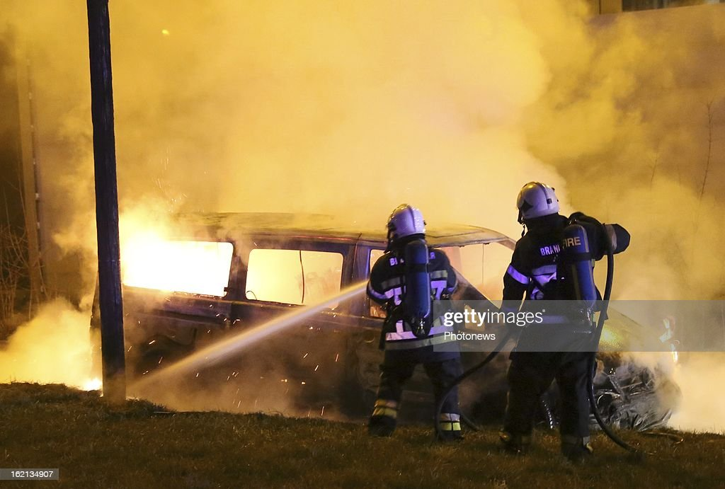 Firemen extinguish the burnt out remains of the van used in the heist near Brussels Airport on February 18, 2013 in Zaventem, Belgium. Using a van and car to break down the security fence a gang of robbers stole diamonds estimated to be worth 50 Million Euros from a security van.