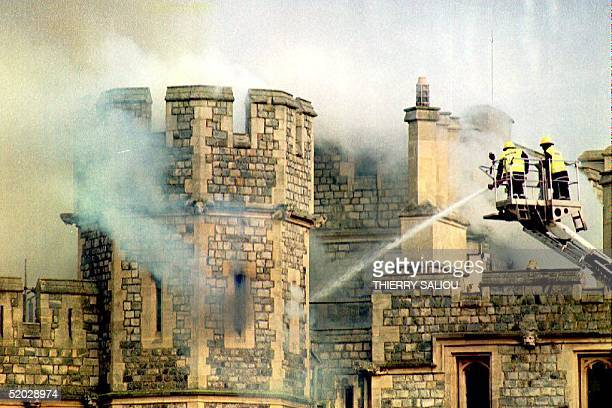 Firemen fight a huge blaze 20 November 1992 at Windsor Castle in England It was reported that the fire started in the private chapel Over 100...