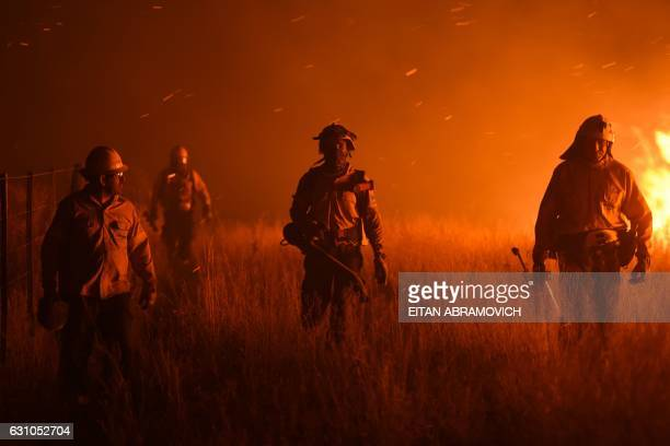 TOPSHOT Firemen fight a wildfire near La Adela in La Pampa Province on January 5 2017 Firefighters in Argentina said on January 5 they were bringing...