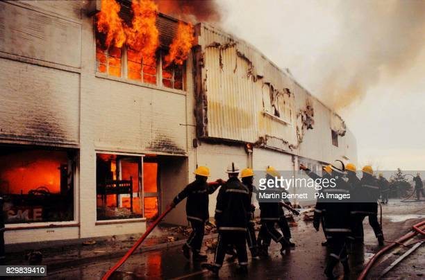 Firemen fight the fire at Leo's Superstore at Staple Hill Bristol today in which a firewoman Fleur Lombard died after she was struck by collapsing...